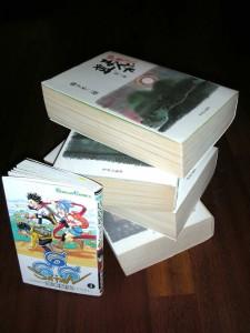 Los 4 mega-tomos de Manga Michi puestos al lado de un 666 Satan de Glénat